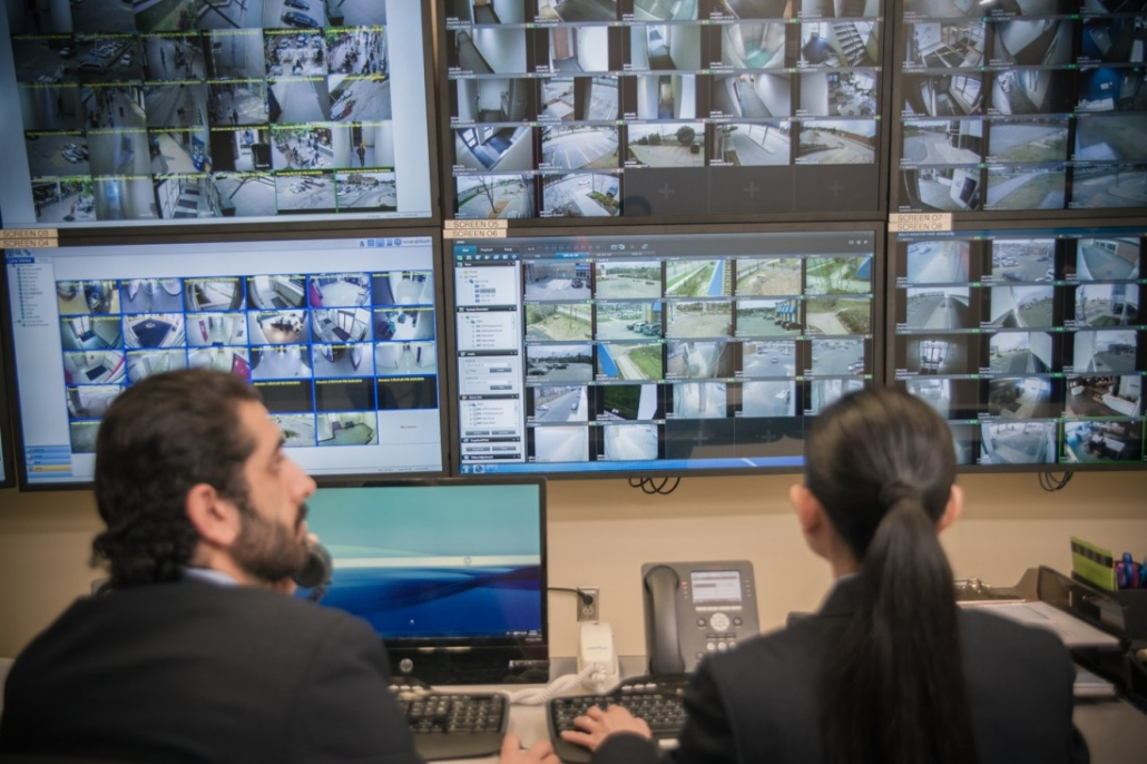 Wincon security guards watching virtual surveillance monitors for systems integration