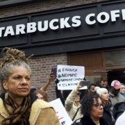 Activists picketing outside starbucks coffee location