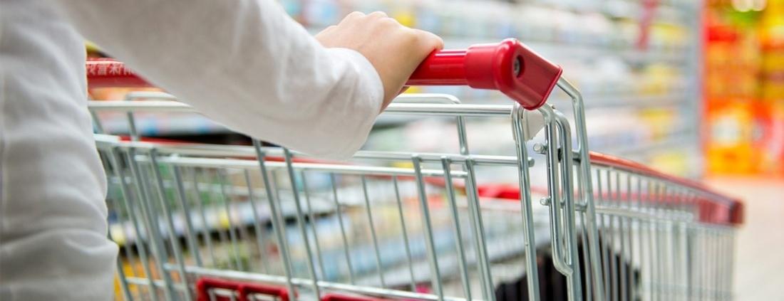 woman pushing shopping cart - shoplifting security guards