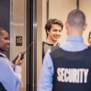 Wincon security guards help guests near condo elevator